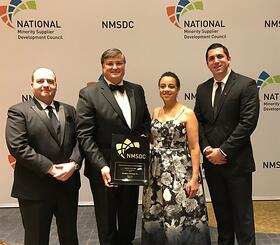 Belisario and Team accepting award 2.jpg